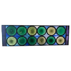 Wonderful blue glass background on the roundel stained glass window