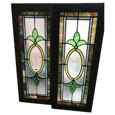 Matched pair of starburst center stained glass windows