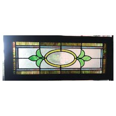 Stained glass window with starburst beveled center
