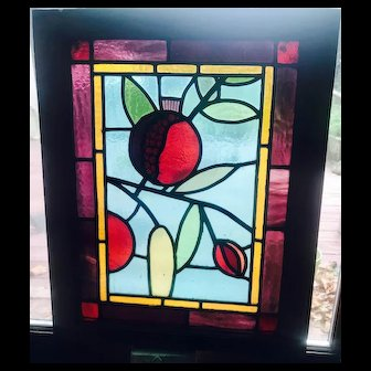 Interesting small stained glass window with fruit