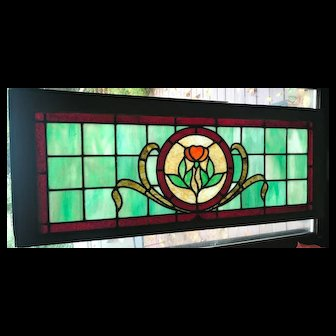 Tulip stained glass window removed from 1908 Pennsylvania house.