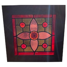 Vibrant colors and jeweled stained glass window