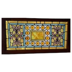 One of a matched pair of  jewels and roundels windows