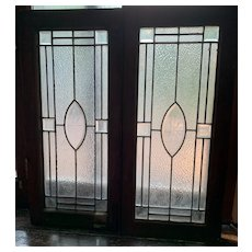 Pair of beveled starburst center stained glass windows