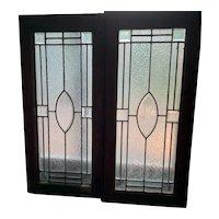 Pair of beveled starburst center stained glass windows