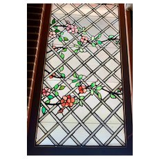 Large rose trellis stained glass window