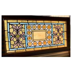 Exceptional combination of roundels, jewels and French crackle glass in stained glass window