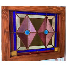 Vibrant  colors in small antique stained glass window