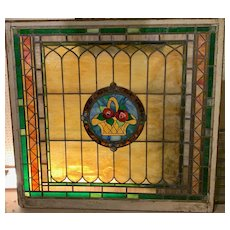 Large basket  of roses  in early 20th century stained glass window