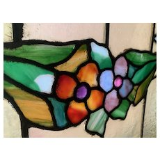 Colorful garland of flowers in the antique stained glass window