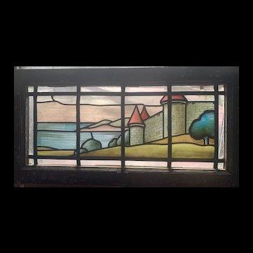 Scenic castle scene in American stained glass window