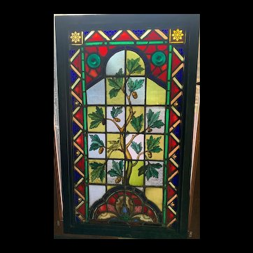 Aesthetic movement stained glass window featuring a bird on a limb