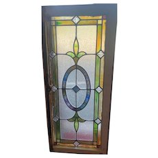 Early 20th century beveled center stained glass window