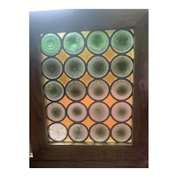 Twenty roundels in early stained glass window
