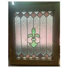 Small fleur  de lis stained glass window