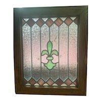 Small fleur  de lis stained glass window
