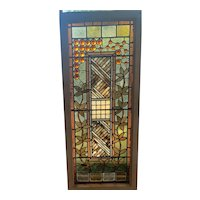 Unusual array of amber jewels in unique  stained glass window