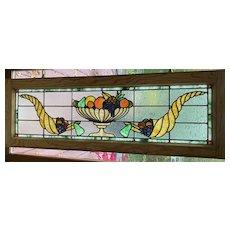 Antique cornucopia stained glass window