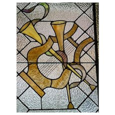 Harp and horns musical instruments stained glass window