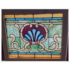 Victorian stained glass window with intricate detail