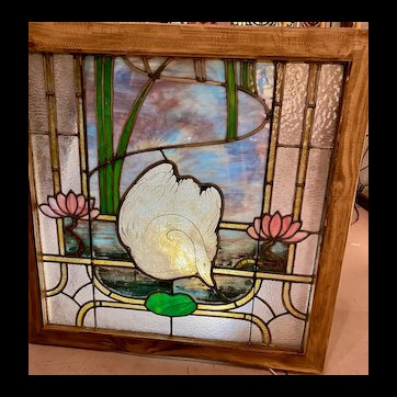 Painted and fired swan stained glass window