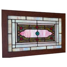 Nice small jeweled and beveled stained glass window