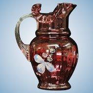 Enameled Cranberry Glass Pitcher