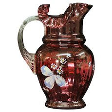 Enameled Cranberry Glass Pitcher
