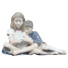 Royal Copenhagen Bing & Grondahl Children Reading Figurine