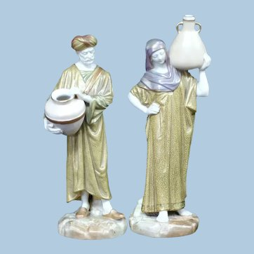 A Pair of Royal Worcester Figures of Cairo Water Carriers
