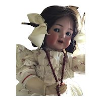 German Bisque K *R Flirty Eye, Fully Jointed Toddler, 20""