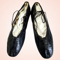 Black Victorian era kid leather shoes with straight leather sole date from the 1840s