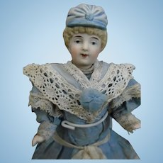 Antique c1900's German All Bisque Mignonette doll with rare blue boots and molded blue bonnet