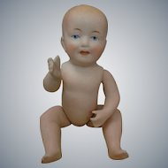 Adorable Limbach all-bisque baby doll measures approximately 6.5 inches long