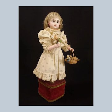 "French musical automaton ""Little Girl with basket of flowers"" by Leopold Lambert, came from estate of Huguette Clark"