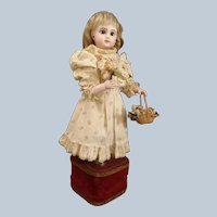 """French musical automaton """"Little Girl with basket of flowers"""" by Leopold Lambert, came from estate of Huguette Clark"""