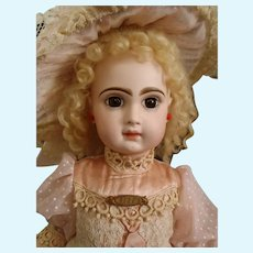 Earlier c1878 French bisque closed mouth BEBE by Emile Jumeau, signed body with voice box