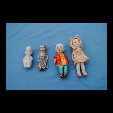 4 20th c. Japanese All Bisque Dolls