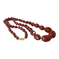 Art Deco Cherry Amber Bakelite Bead Necklace. Olive Shaped Faceted Beads.