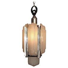 (7) 1930s Lightolier Luxart Chandeliers
