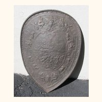 Antique Cast Iron Shield with a Battle Scene of Worriers on Horseback..