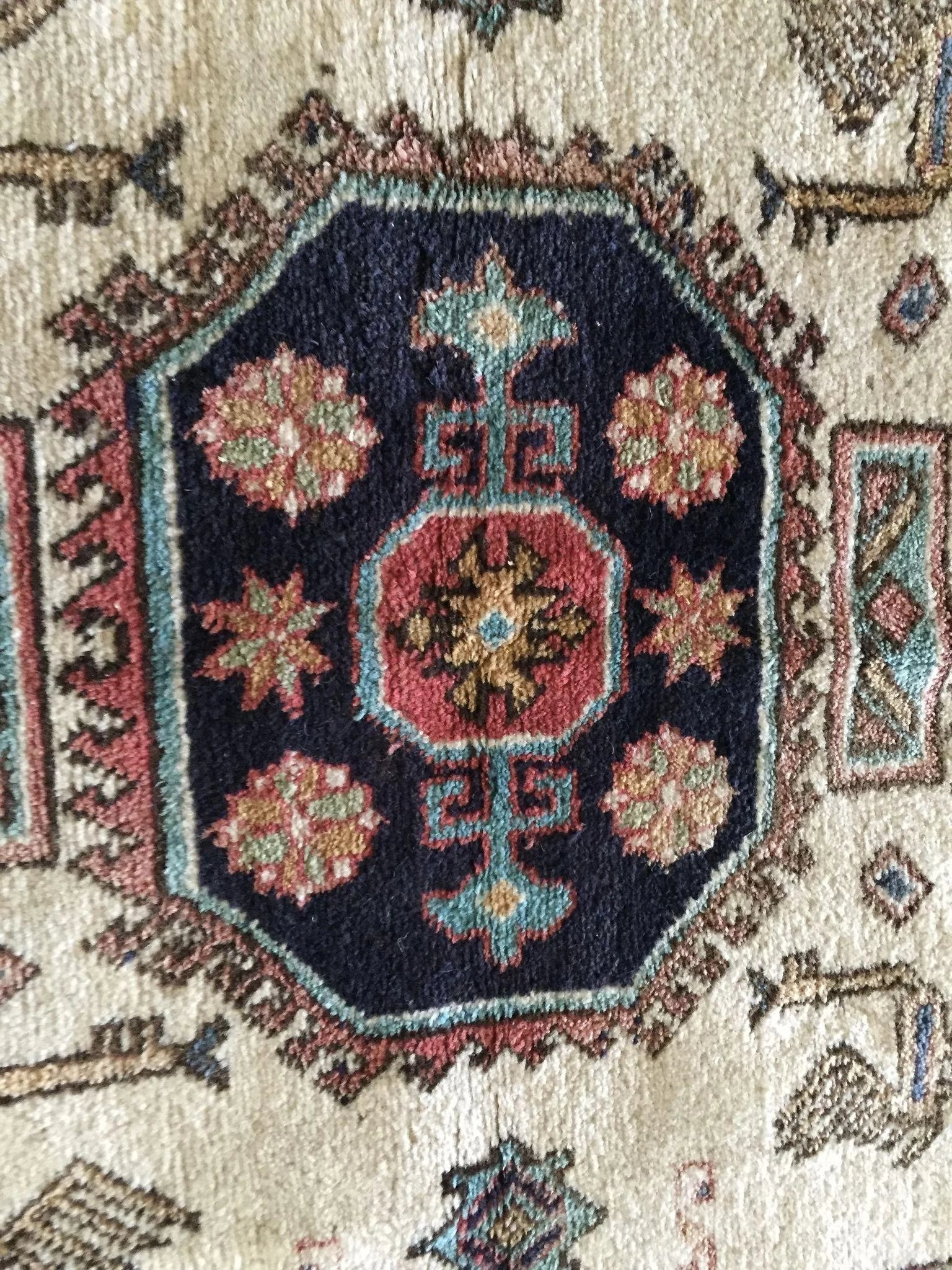 old persian wool rug animal and floral motif   the steffen collection