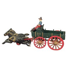 """Large Hubley Cast Iron Toy Farmer and  Wagon  11 """" long"""