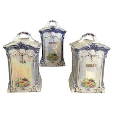 Set oƒ Three Tall Jars or Porcelain Canisters