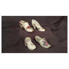 Four Miniature Porcelain Shoes Signed