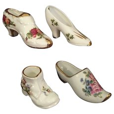 Four Miniature Porcelain Shoes Signed