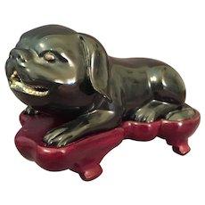 Asian Dog like Figure