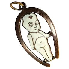 1920's Charm / Pendant, Enamel Kewpie Doll in Horseshoe