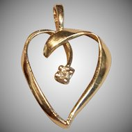 Gorgeous Cut Out Heart Pendant with A Diamond Accent in 14K Yellow Gold