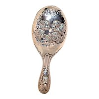 Reynolds Angels Sterling Silver Repousse Hand Mirror